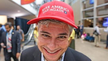 "Ed Greenleaf, a South Carolina delegate, shows off his hat mimicking Donald Trump's ""Make America Great Again"" slogan."