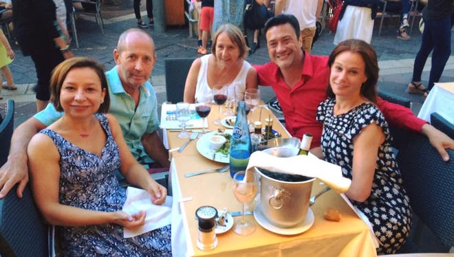 Richmond High School graduate Andrew Gentry, second from left in red, dines with friends, from left, Adelina Vestemean, Ken Ash, Jane Warren Peachey, and, Carina Lindberg in Nice, France, shortly before the terror attack during Bastille Day celebrations. Gentry and his friends were uninjured, but did run from the area in fear.