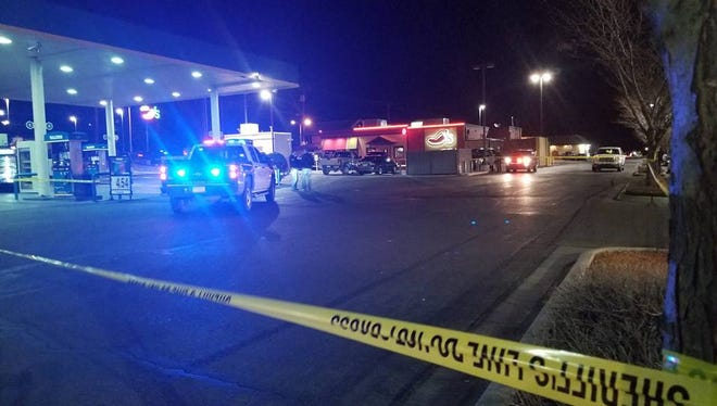 Police secure the scene at the Valero gas station at 4913 E. Main St. in Farmington after police fired on aggravated battery suspect Ryan Westman as he attempted to flee on Thursday.