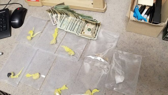Wayne County Sheriff's Office deputies confiscated more than 30 grams of heroin, 4 grams of methamphetamine and more than $500 cash after a Thursday traffic stop in the 2200 block of East Main Street.