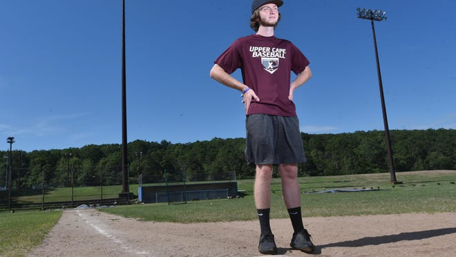 Baseball has always been a big part of life for Mike Petit, shown here standing at the Sandwich High field. Petit remembers hitting whiffle balls with his father in the family's backyard in East Sandwich.