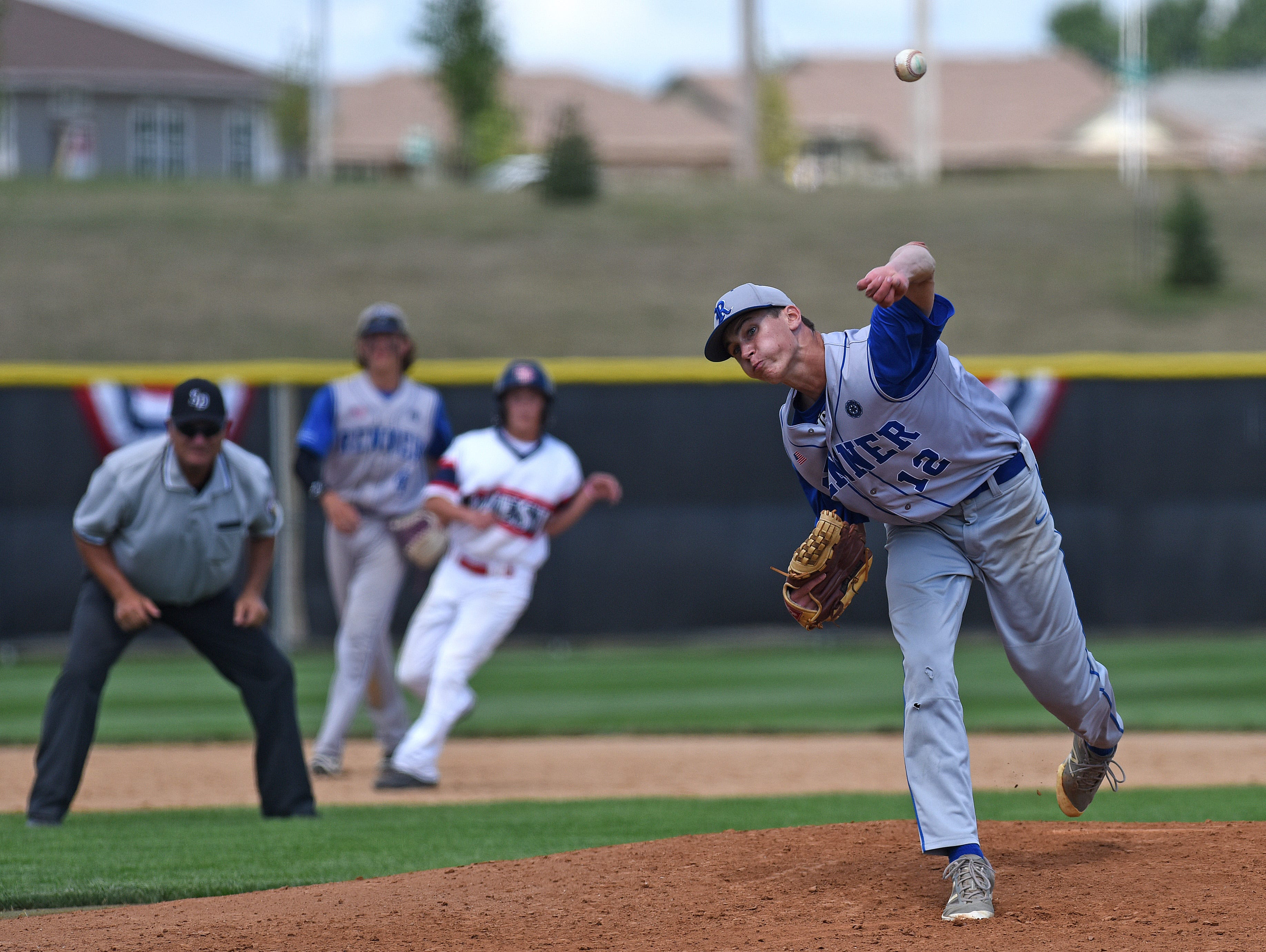 Runner's #12 Spencer Koelewyn pitches against Sioux Falls Post 15 West during American Legion Class A Baseball State Tournament at Harmodon Park in Sioux Falls, S.D., Wednesday, July 27, 2016.