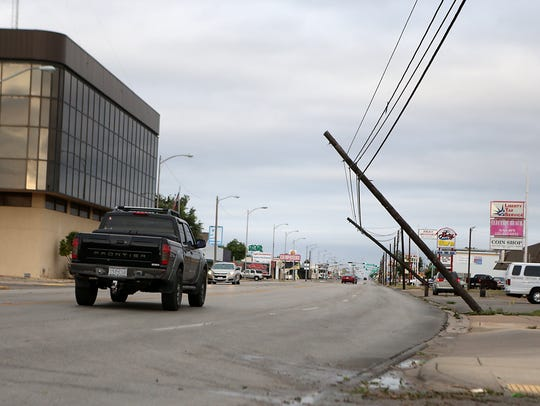 Utility poles hang from power lines on Sherwood Way