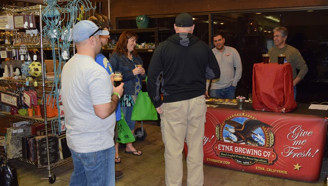 Customers sample beer at last year's Hops & Shops event.