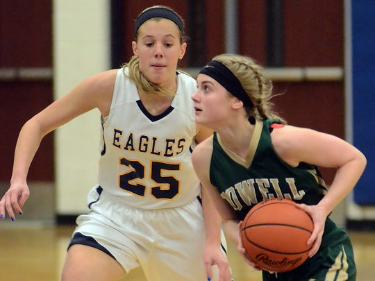 Howell's Paige Johnson (right) and Hartland's Lexey