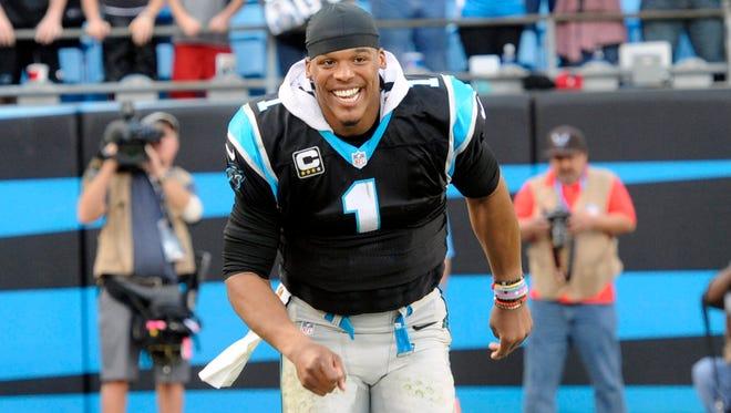 Dec 13, 2015; Charlotte, NC, USA; Carolina Panthers quarterback Cam Newton (1) celebrates as his team goes 13-0 against the Atlanta Falcons at Bank of America Stadium. Panthers win 38-0. Mandatory Credit: Sam Sharpe-USA TODAY Sports