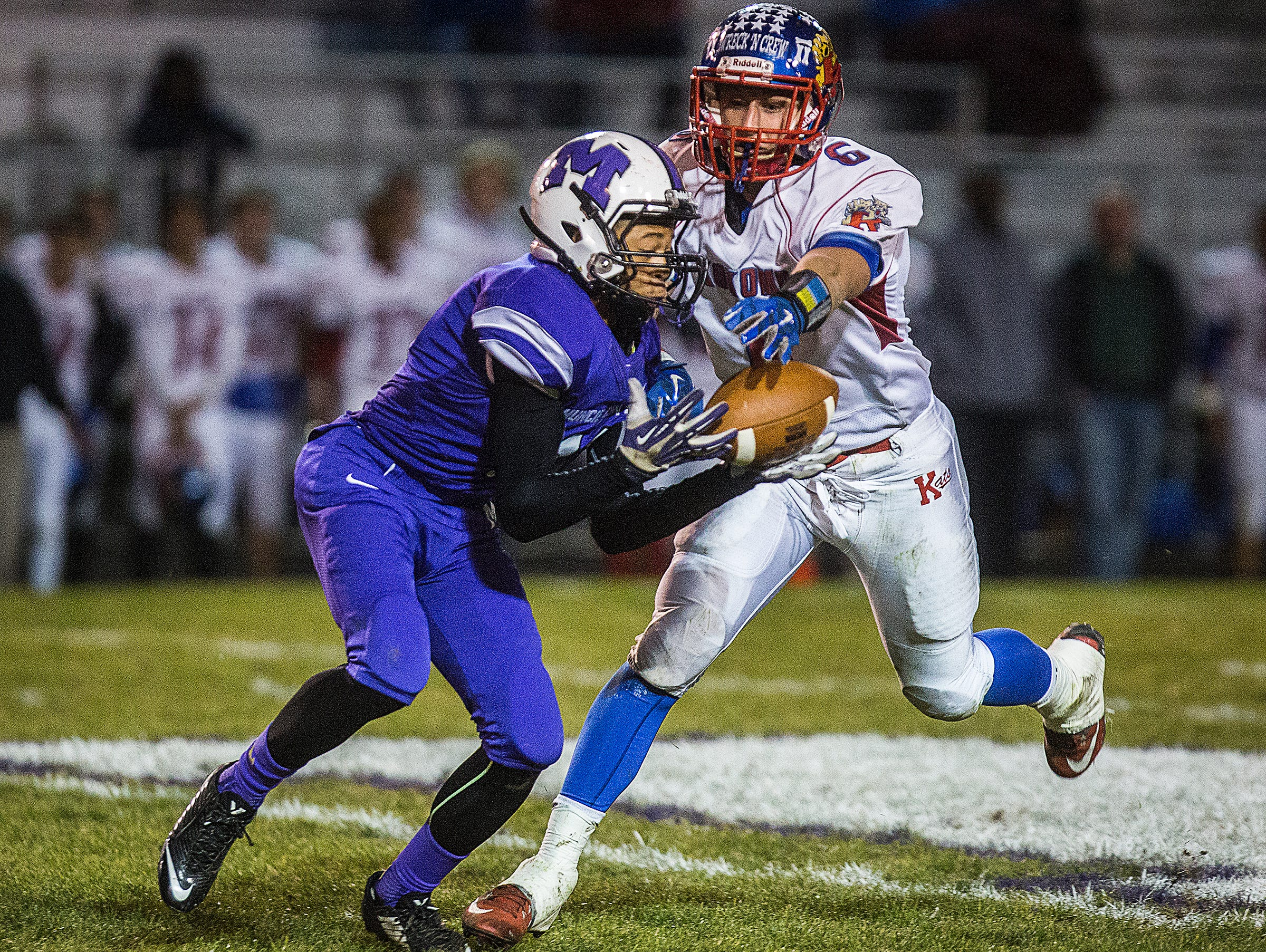 Central's Eliseus Young catches a pass from Trenton Hatfield past Kokomo's defense during their game at Central Friday, Oct. 30, 2015.