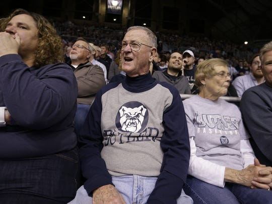 Butler superfan Wally Cox sits in the first row behind the scorer's table and cheers on his Butler Bulldogs, March 2, 2016.