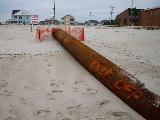 A beach replenishment pipe is in place near 7th Avenue