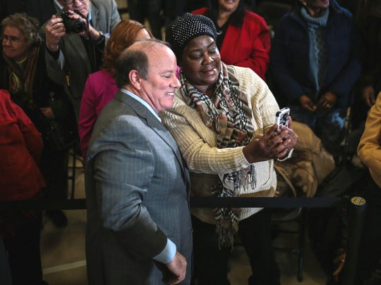 Jeannine Woods of Detroit takes a selfie photo with Detroit Mayor Mike Duggan after announcing his decision to run for a second term as Mayor of Detroit.