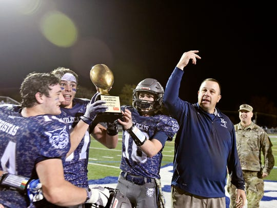 Dallastown receives the MaxPreps Rivalry Series trophy after winning a YAIAA football game Friday, Nov. 3, 2017, at Dallastown. Dallastown defeated Red Lion 40-27.