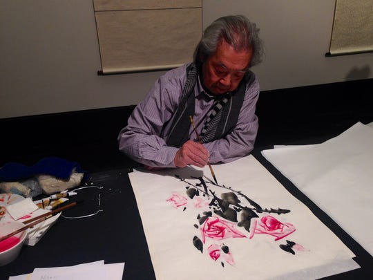"Chinese artist Chen Yuhua demonstrates his painting technique at the Alexandria Museum of Art during the opening reception for his exhibit ""Chen Yuhua: The Dao of Nature"" Friday. The exhibit will be open through the end of May."