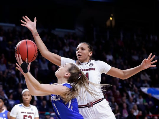 South Carolina's Mikiah Herbert Harrigan (21) defends as Buffalo's Stephanie Reid (1) shoots during the second half in a regional semifinal at the NCAA women's college basketball tournament Saturday, March 24, 2018, in Albany, N.Y. South Carolina won 79-63. (AP Photo/Frank Franklin II)
