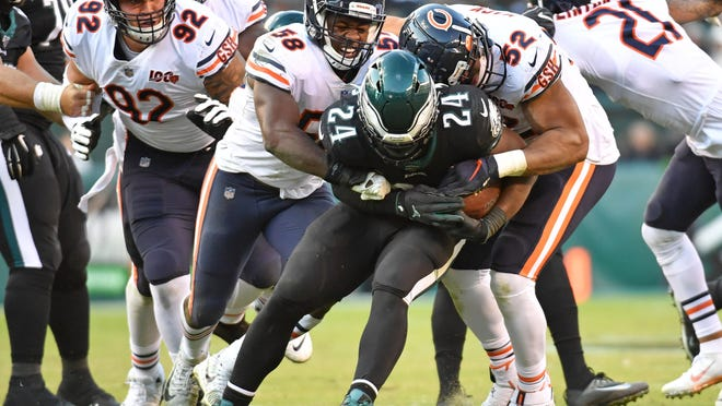 Philadelphia Eagles running back Jordan Howard is stopped by Chicago Bears inside linebacker Roquan Smith (58) and outside linebacker Khalil Mack (52) last season, when Howard faced his original NFL team.
