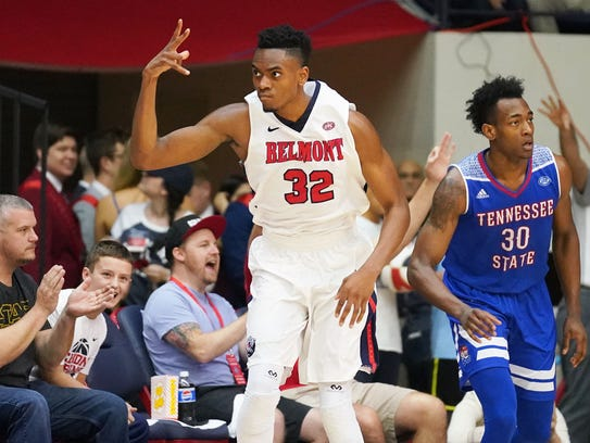 Belmont's Amanze Egekeze throws up three fingers to the crowd after making a 3-pointer in Saturday's game against Tennessee State at Curb Event Center.