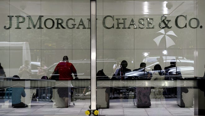 This  2012 file photo shows  the  entrance to the JP Morgan Chase World Headquarters on Park Avenue in New York.
