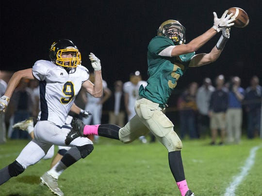 York Catholic's Ryan Sewell beats Littlestown's Ben Snouffer but is unable to haul in the pass  Friday, Oct. 7, 2016.