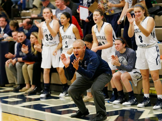 Central Catholic head coach Craig Devault cheers his players as they face Fountain Central Tuesday, December 20, 2016, in Lafayette. CC defeated Fountain Central 53-45.