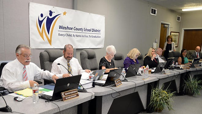 Washoe County School Board members, left to right, Howard Rosenberg, Dave Aiazzi, Barbara McLaury, Barbara Clark, Lisa Ruggerio, John Mayer and Estela Gutierrez, converse during a meeting. On the far right is Randy Drake, the board'??s attorney.