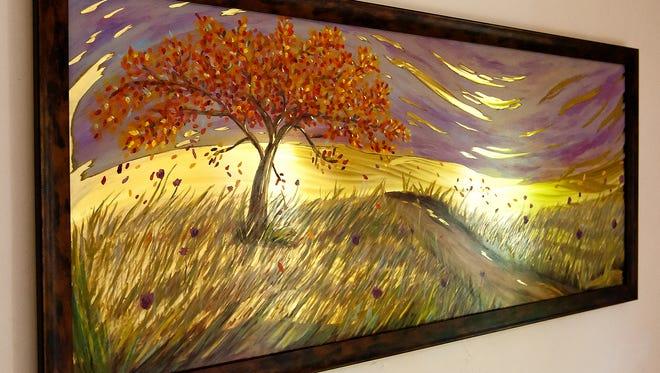 """Autumn Tree"" is a sculptured fine art piece on brass."