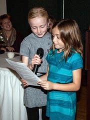 4-H members Savannah and Taylor display their public speaking skills at the annual 4-H Banquet