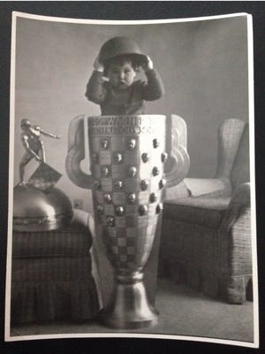 Lawrence native Liz Freiherr at age 2 inside of the Borg Warner trophy. Freiherr's father was the keeper of the trophy for 30 years.
