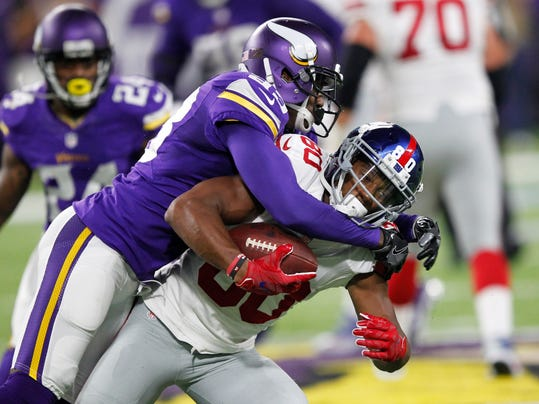 FILE - In this Oct. 3, 2016, file photo, Minnesota Vikings cornerback Terence Newman, left, tackles New York Giants wide receiver Victor Cruz during the first half of an NFL football game, in Minneapolis.  Thirteen years after the Dallas Cowboys drafted Terence Newman, the old cornerback is still going strong for the Minnesota Vikings. His current team faces his original team on Thursday.  (AP Photo/Andy Clayton-King, File)