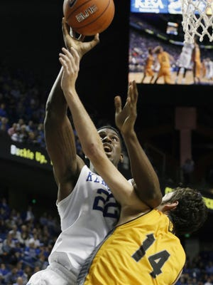 Kentucky's Alex Poythress, left, shoots under pressure from Ottawa's Logan Bullinger during the second half of an NCAA college basketball exhibition game Monday, Nov. 2, 2015, in Lexington, Ky. Kentucky won 117-58.
