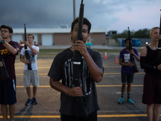 The Flour Bluff High School Navy Junior ROTC rifle drill team practices in August 2017 at the high school.