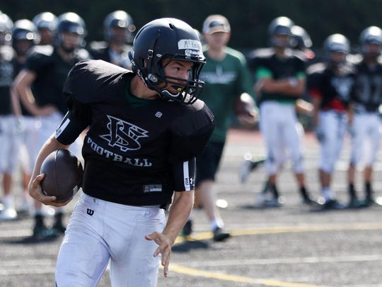 Lucas McKnight runs the ball during practice on Friday, Aug. 21, 2015, at West Salem High School.