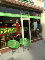 Asbury Park businesses, such as Juice Beach, festively decorate their windows for the holiday season.