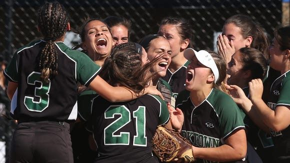 Yorktown players celebrate their 5-3 victory over Kingston to win the girls Class AA regional semifinal at Middletown High School June 1, 2017.