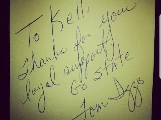 In June of 2013, MSU fan Kelli DeVlieger ran into Tom Izzo outside a grocery store. Reluctantly, she approached him and came away with this note and autograph. Nearly five years later, she is repaying MSU's head basketball coach of her own, showing him support during a tumultuous time on campus.
