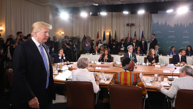 President Trump arrives late to a Gender Equality breakfast at the G7 meeting in Charlevoix, Canada, June 9, 2018.