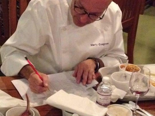 Chef Marty Cosgrove of K-Paul's Louisiana Kitchen judges during the 2014 Soiree Royale.