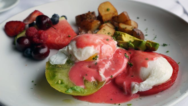 Skip the bread and enjoy these poached eggs over sliced heirloom tomatoes. It's an explosion of color on the plate that offers a great mix of tastes on the palate.