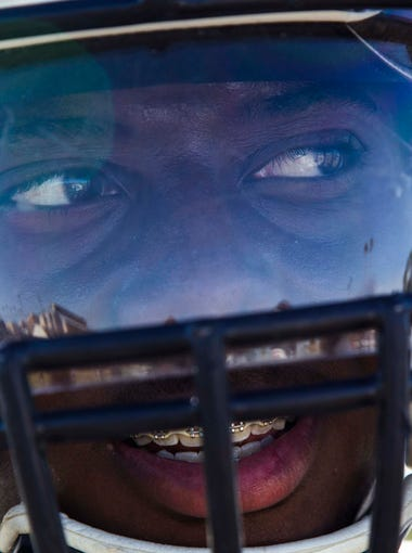 Tyrese Green of McClintock High School football team practice with his team.