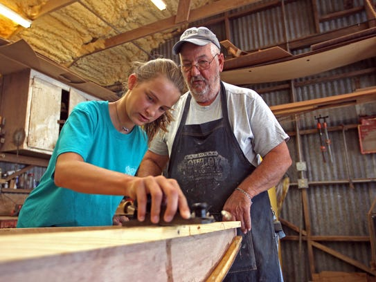 Steve Woods, pictured here helping Adair Bates build