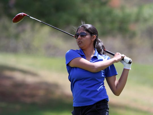 Holmdel's Mehr Sawant watches her tee shot on the 14th
