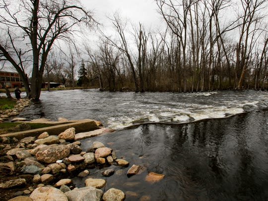 Rapids flow in the Grand River near Old Mill Street