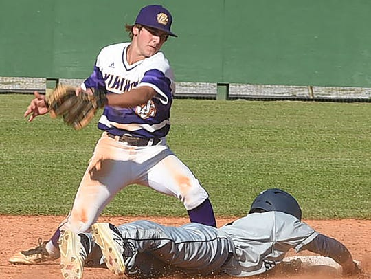 An Episcopal player slides into base during their game