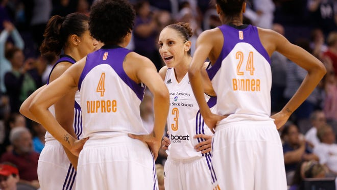 Phoenix Mercury guard Diana Taurasi talks with her teammates during a timeout with the Seattle Storm during the fourth quarter at US Airways Center in Phoenix.