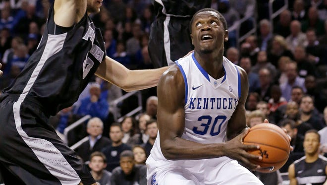 Kentucky's Julius Randle (30) is defended by Providence's Kadeem Batts (10) and Carson Desrosiers (33) during the first half of an NCAA college basketball game Sunday, Dec. 1, 2013, in New York. (AP Photo/Frank Franklin II)