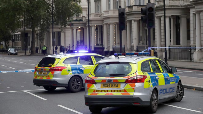 Police cars at the scene of an incident in central London, on Oct. 7, 2017.