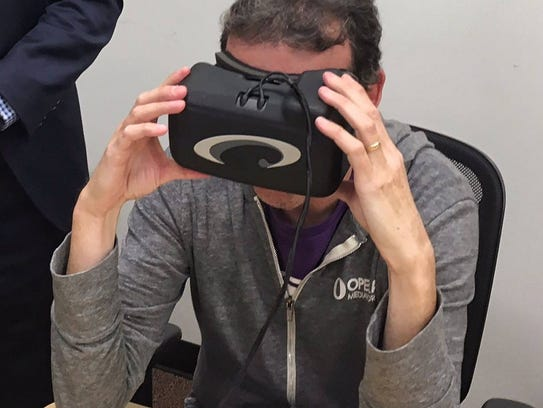 Reporter Jon Swartz tries on a set of virtual reality