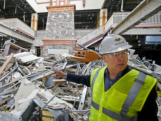 Developer Don Sinex gives a tour of the demolition