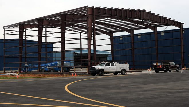 Eli Baylis/Hattiesburg American Construction continues Thursday on an airplane hangar at the Hattiesburg-Laurel Regional Airport. Construction continues on an airplane hanger at the Hattiesburg-Laurel Regional Airport Thursday.