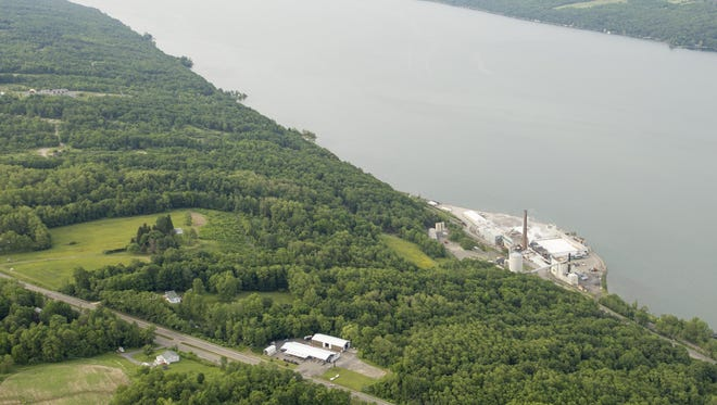 The U.S. Salt mine complex, right, sits on the shore of Seneca Lake, in the town of Reading, looking north up the length of Seneca Lake. Crestwood is proposing to store liquid propane gas in caverns created from the salt mining.