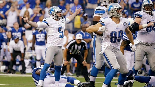 Detroit Lions kicker Matt Prater (5) celebrates a game-winning field goal in the final seconds of the game against the Indianapolis Colts in an NFL football game in Indianapolis, Sunday, Sept. 11, 2016. The Lions defeated the Colts 39-35.