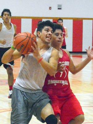 Loving senior guard Joel Hernandez drives to the basket against senior point guard Michael Valdez during Tuesday's practice.